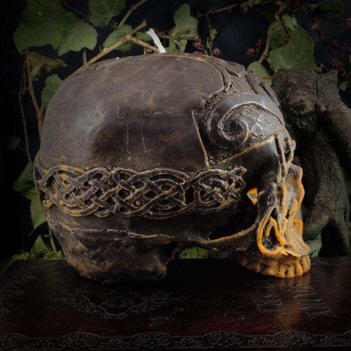 orange-and-brown-celtic-viking-skull-candle-side-view